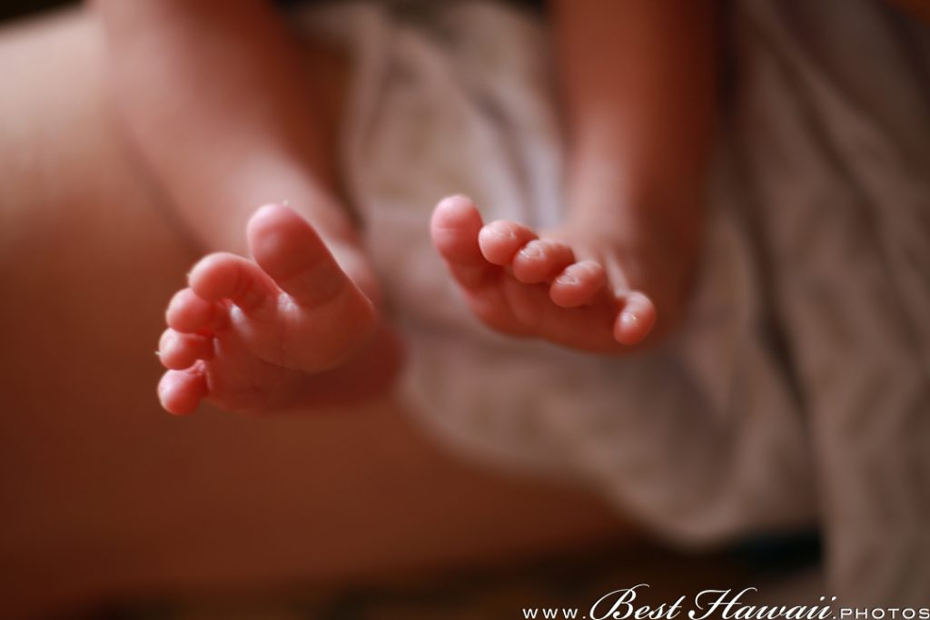Tiny toes of our newborn daughter